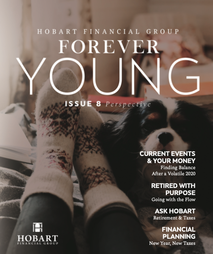 Hobart Wealth's Forever Young Newsletter - Winter 2021 cover picture of a woman's toaty feet in thick socks and a puppy snuggled close up. List the topics in issue #8, including current events and your money, retired with purpose, Ask Hobart - topic taxes & retirement.